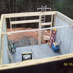 Sill plate and rear basement wall framing is started.