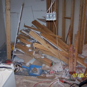 we started by removing the old closet walls to open up the bathroom's floor plan