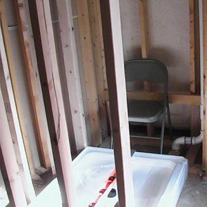 built rough framed walls for new shower, moved waste pipes to route under and beside where new bench would sit, installed pre-fab shower basin...