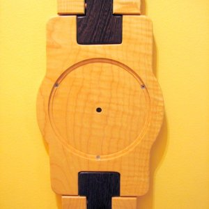 "This is a clock I built that looks like a wristwatch. It is 36"" tall. The lighter wood is tiger maple, the dark wood is wenge from Africa."