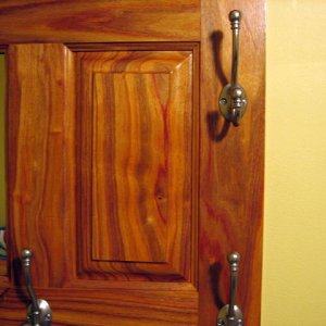 This is a victorian style coatrack I made out of canary wood. Raised panels on each side with a mirror in the middle.