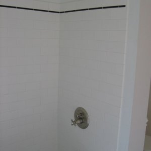 New tub with white tile, brick shaped in a running bond pattern.