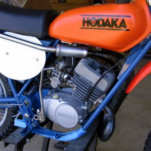 One of my vintage racers I restored. It is a 1974 Hodaka Super Combat, 125cc two stroke. I rebuilt the engine from the cases up. Every nut and bolt...