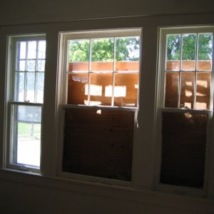 biggest bank of windows (then broken and boarded) -- dining room
