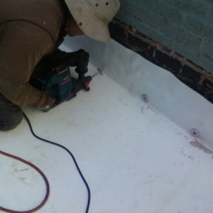 Base tie in on a PVC roof, mechanically fastening the roof to the wall.