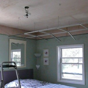 removed a drop ceiling from bedroom