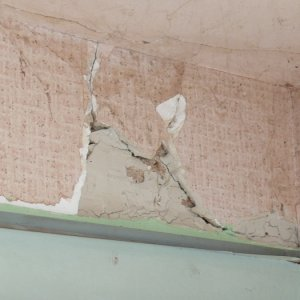 old ceiling and walls are cracked plaster