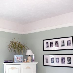 """Finished texturing, added a """"paintable"""" textured border. Left it white. Added trim painted in an off-white. Crooked walls meant lots of caulk on trim..."""