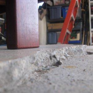 Garage floor with excessive settling
