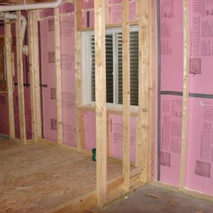 """Raised floor landing and 2"""" foam on west wall (coldest wall)."""