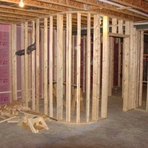 Curved walls- this one happens to be (unofficially load bearing).  Not by code- but the long joist spans above caused shaking on the floor above. ...