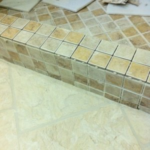 tiling of the curb, the flooring is the allure traffic master vinyl planks.