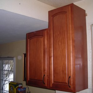 "Installing ""transition"" upper cabinets over peninsula [range wall, left side] - The sunken dining room ceiling drops 10"" so we have a 42"" upper in..."