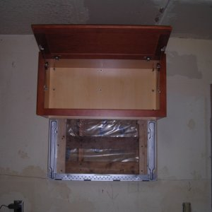 "Installing microwave upper cabinets [range wall] - This is a 12"" deep cabinet that supposedly goes over built in fridges but it worked great over our..."