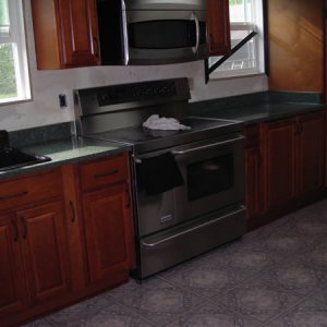 Countertops installed! [Range wall] - Only part of the project we had professionally installed.    (Products: Thomasville Cabinetry, Dupont Zodiaq...