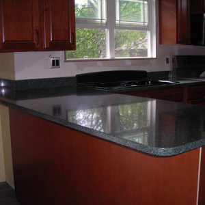 "Countertops installed! [Peninsula ""bar"" in dining room] - Only part of the project we had professionally installed.  We finished the backside of the..."