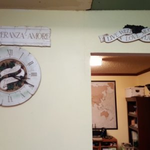 Love it! Found the cutest Italian themed art. The signs & clock are some kind of cement & plastic composite.