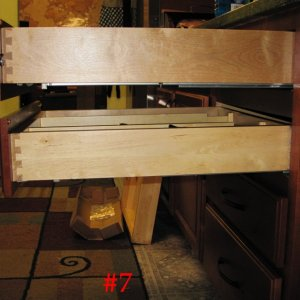 As I noted I regretted paying for the soft-close drawer slide upgrades when I'd bought the Thomasville cabinetry.  This is why.  The top drawer has...