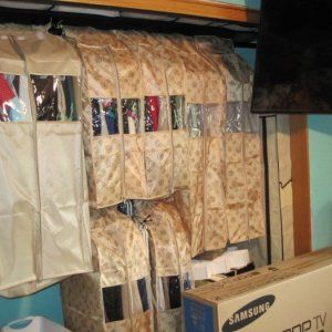 Closet organization master level - love it!    There's sliding mirrors that go over this, but I'm in the process of painting all the doors, trim, and...