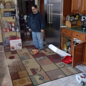 This is what the kitchen looked like after the quake, RICE EVERYWHERE lol    But that massive 7' x 4' fridge is strapped onto four studs on the wall...