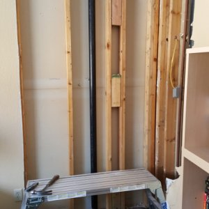 "First things first the dry wall had to go.  We cut out for 4' x 8' wood sheets on each wall in the corner here (3' 11.5"" on one side to account for a..."