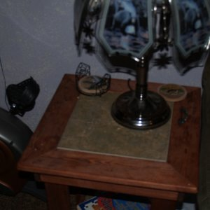 End table. stained pine with inset floor tile.