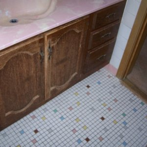 rainbow floor tile and shell sink