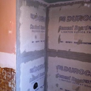 Dry thinset and tape- silicone calk along tub
