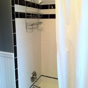 everything calked, new fixtures, and shower curtain
