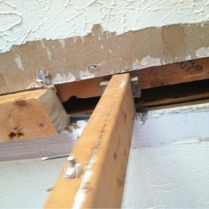 2x4 holding up saggy parts. There is nothing to attach drywall to finish ceiling.
