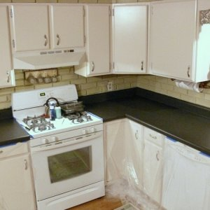 Its been 6 years since the cabinets were painted so time for a fresh look. Offwhite cabinets with Spreadstone countertop kit