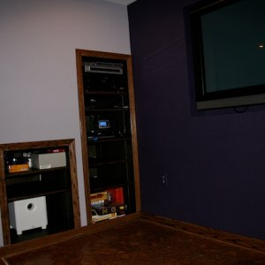 Under stair cabinets hold A/V gear.