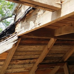 Northeast corner of box in roof has been slid south allowing north west roof to drop