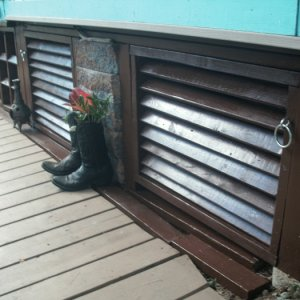 GEDC0401 diy louver doors. Louvers can be closed in winter time to stop cold drafts. Doors not exactly square bc had to match the unevenness of deck...