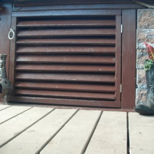 GEDC0402 diy louver doors. Louvers can be closed in winter time to stop cold drafts. Doors not exactly square bc had to match the unevenness of deck...