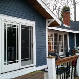 Back of house finished with new hardi-trim, hardi-plank siding, and corbels.