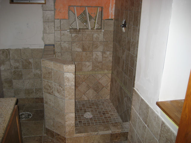 5) Shower in progress. Custom built niche