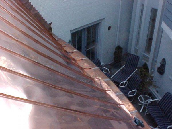 A view of a roof that changes from a 5/12 to 18/12 pitch in 25 feet.