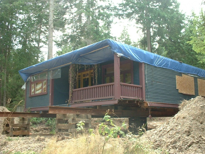 All it needs now is a foundation and a roof and plumbing and re-wiring and new front steps and a wood stove and a dining room bay window and...