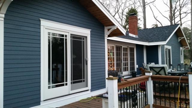 Back of house finished with new hardi-trim, hardi-plank siding, and corbels.