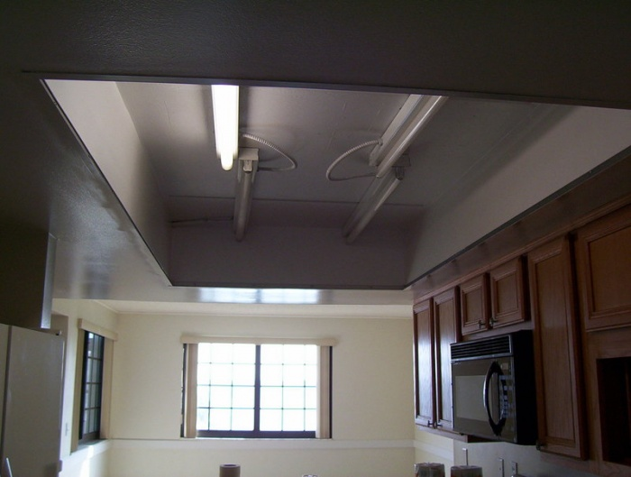 Before we removed the florescent lighting from the concrete ceilng.