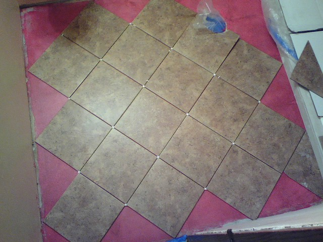 Dry fitting tile floor on the diagonal