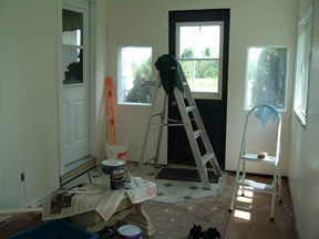 During...panelling gone, t&g pine installed on the ceiling and all around the room
