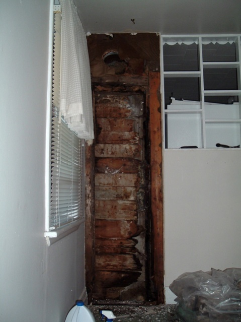 Ended up tearing down this whole wall, which turned out to be weight bearing, even with the lattice shelves! It's now solid. Was alot of mould and rot in there! All rebuilt fresh now, but quite the job.