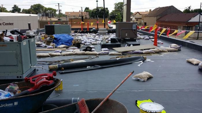 EPDM roof installation in progress.