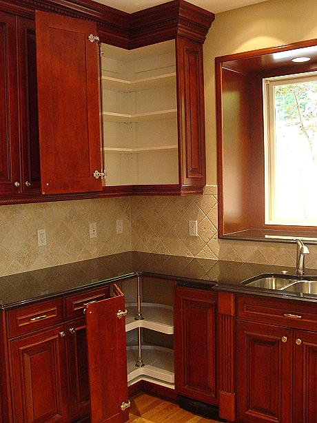 Euro style stained Maple Kitchen with wite Melamine inside.