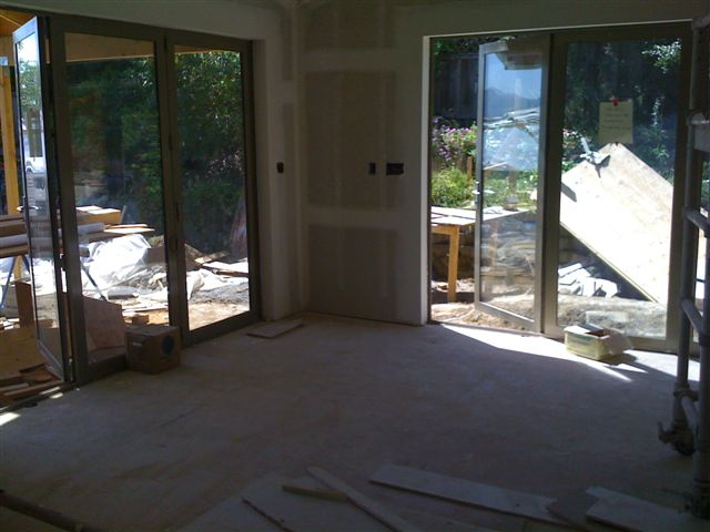 folding doors in room,  wood  flooring will probably run parerellel to door on left.