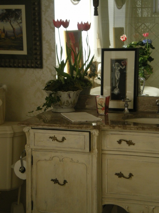 French Victoria Bath. This was an antique sideboard that I had painted in a distressed finish and added a French Limestone top called Napolean Taupe.