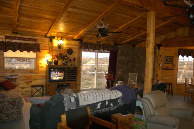 Here is looking west. Cedar on the ceiling, juniper and pine on the walls. The construction is post and beam and is all rough cut from timber we fell in the woods and milled up ourselves.
