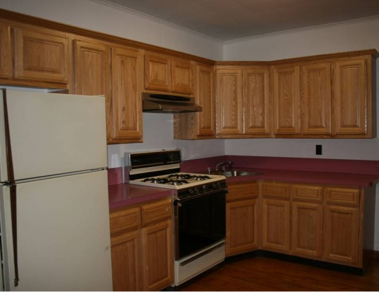 Here is the after picture of the cabinets after refacing them.  Phase I of the new kitchen; next will be the counter tops.